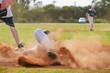 Baseball player sliding into third base