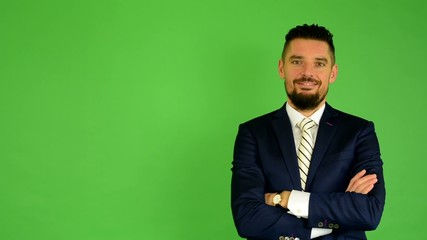 business man smiles - green screen - studio