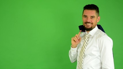 business man smiles(jacket over shoulder)-green screen - studio
