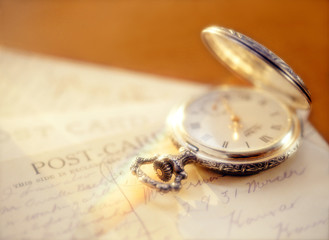 pocket watch and post card