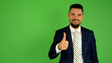 business man shows thumb on agreement - green screen - studio