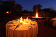 Nighttime campfire and dinner table - 73598026