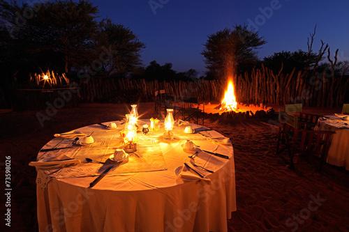 Leinwandbild Motiv Nighttime campfire and dinner table