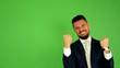 business man rejoices (joy) - green screen - studio
