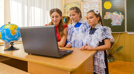 Teachers and students at the computer