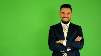 business man smiles (fold arms) - green screen - studio