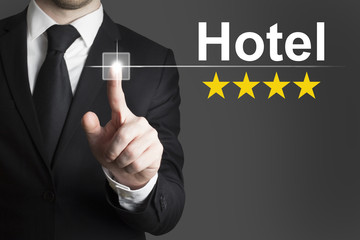 businessman pushing button hotel four star rating