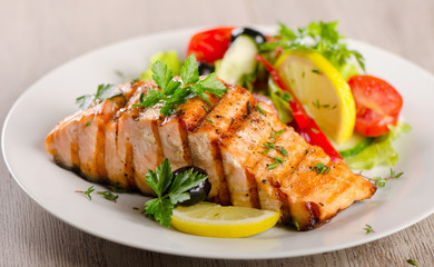 Salmon with  fresh salad.