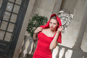 Portrait of a beautiful girl in a red dress