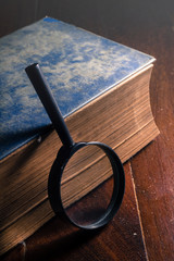 Antique book with magnifier.