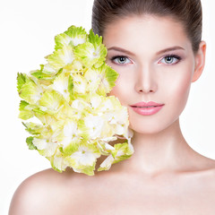 Closeup portrait of young beautiful woman with a healthy clean s