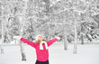 happy girl enjoying life and throws snow at winter outdoors