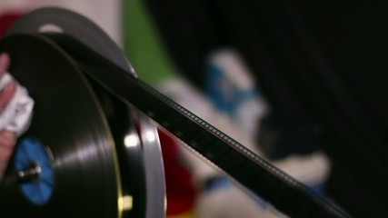 Film Technician Rewinding and Checking 35mm Film