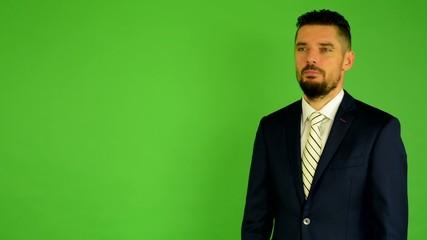 business man speaks (talking) - green screen - studio