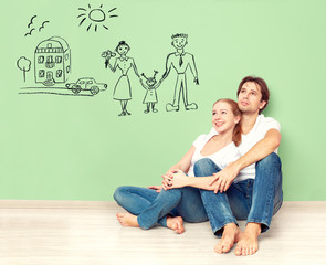 couple dreaming of new house, car, child, well-being