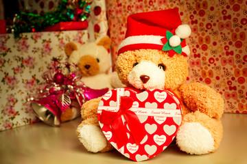 Teddy bear wearing a santa hat.