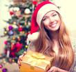 Happy Teenage Girl With Christmas Gift Box