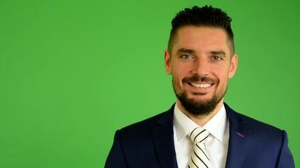 business man smiles - green screen - studio - closeup