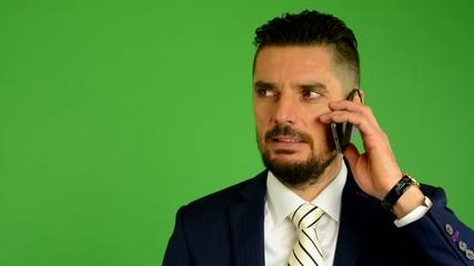 business man phone (serious face) - green screen - closeup