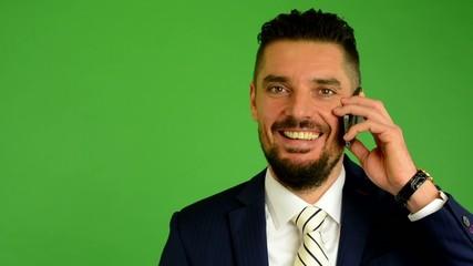 business man phone and smiles- green screen - closeup