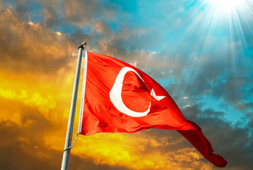 Flag of Turkey waving in the wind with highly detailed fabric te