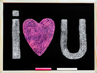 I love you message hand written with chalk on blackboard