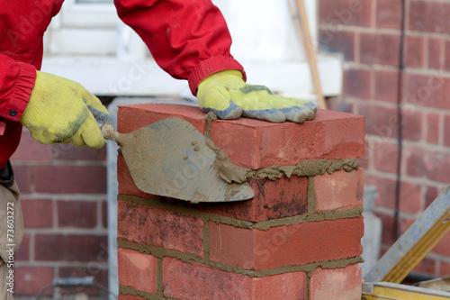 Papiers peints Mur Bricklaying - laying a brick