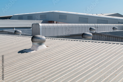 Architectural detail of metal roofing on commercial construction - 73604005