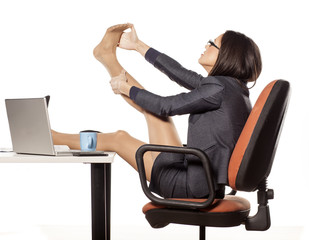 businesswoman with legs on the table massaged her foot