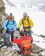 Drei Alpinisten am Gipfel