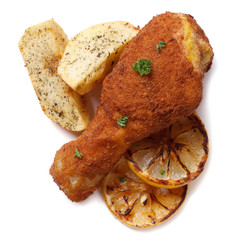 crumbed chicken leg with fried potatoes  isolated on white