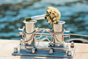 Wedding bouquet on the bollard in yacht club