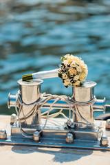 Wedding bouquet on the bollard in yacht club