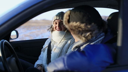 Man and woman talking in the car