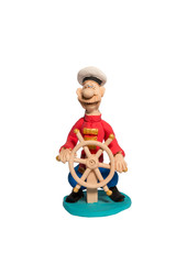 Figurine sailor at the helm