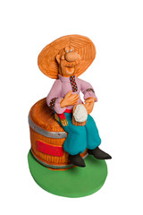 Statuette of a man sitting on barrel beer