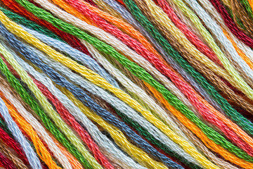 Multicolor sewing threads texture. Diagonal.