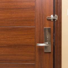 metal door handle on wooden door