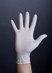 Male palm in latex glove