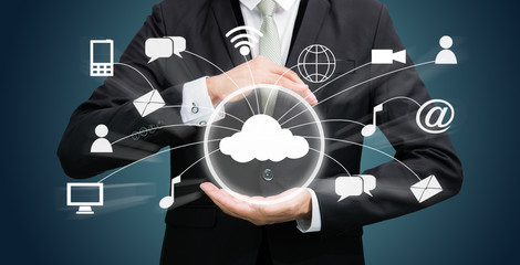 Businessman holding cloud computing network