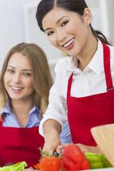 Women Friends Preparing Vegetables Salad Food in Kitchen