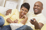 Happy African American Woman Couple Remote Control
