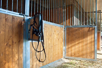 hanging bridles at the horse box