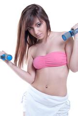 Greek teen exercising with heavy dumbbells on white