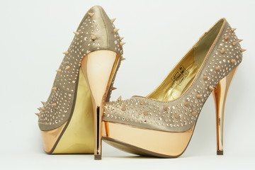Gold shoes with spikes.