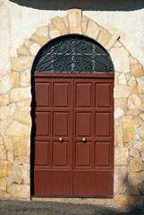 Wooden door with stone