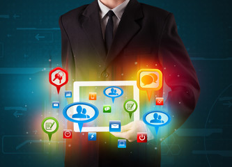 Businessman presenting modern tablet with colorful social signs