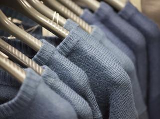 Blue sweaters on shoulders