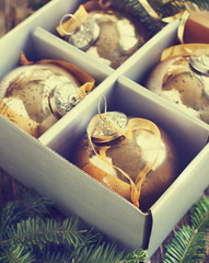 Christmas balls in box. Toned image