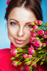 Portrait of Beautiful Young Woman with Flowers. Healthy Skin